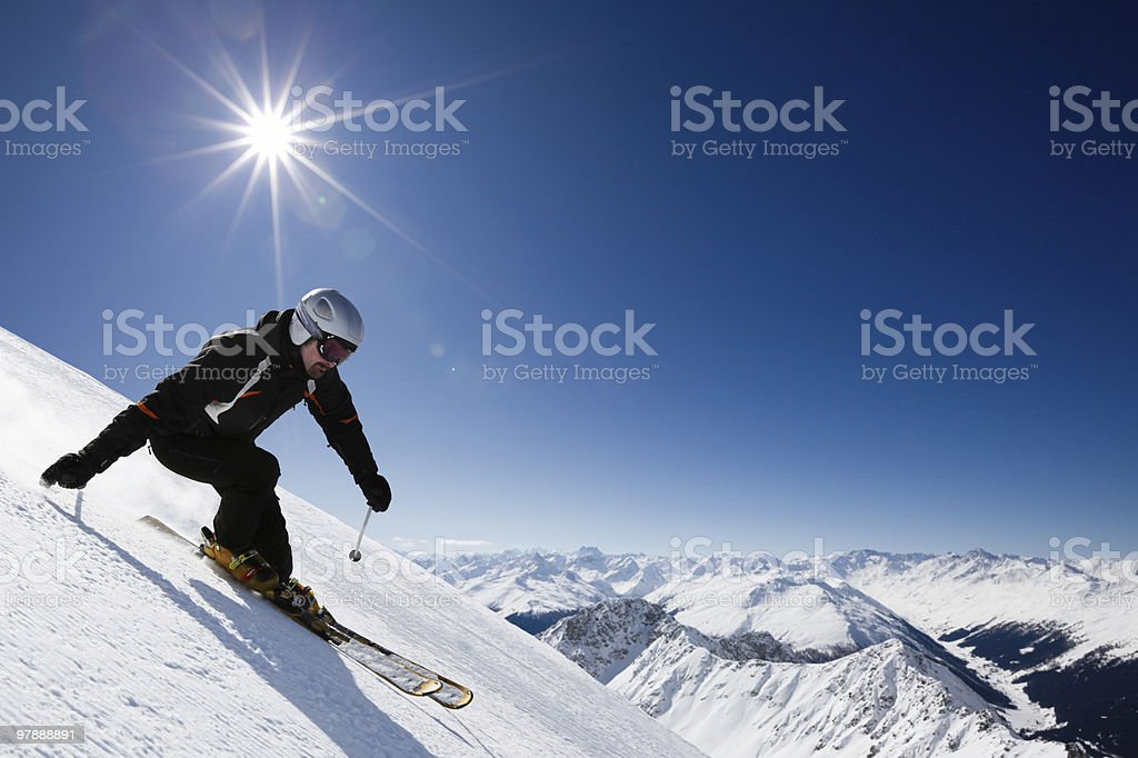 Male skier with mountain view stock photo
