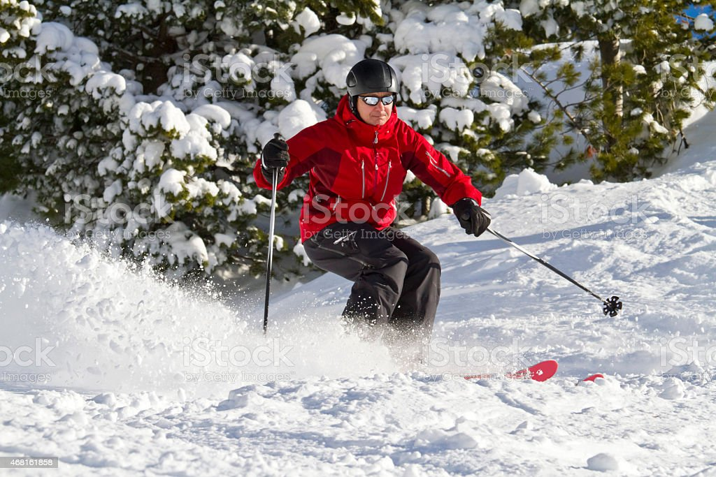 Male skiing forest stock photo