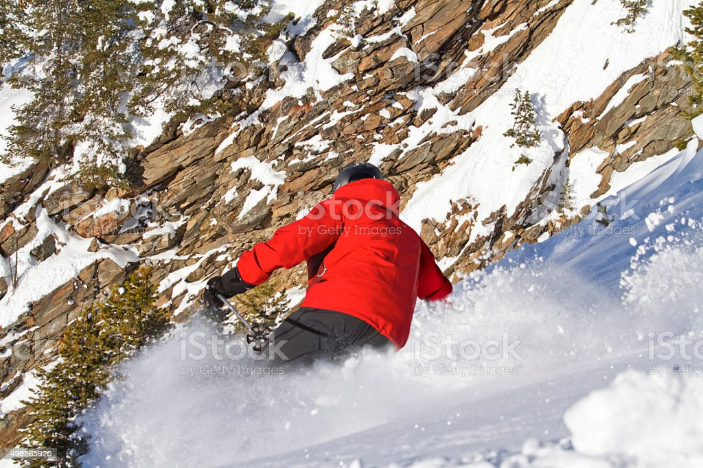 Male skiing in sloping position stock photo