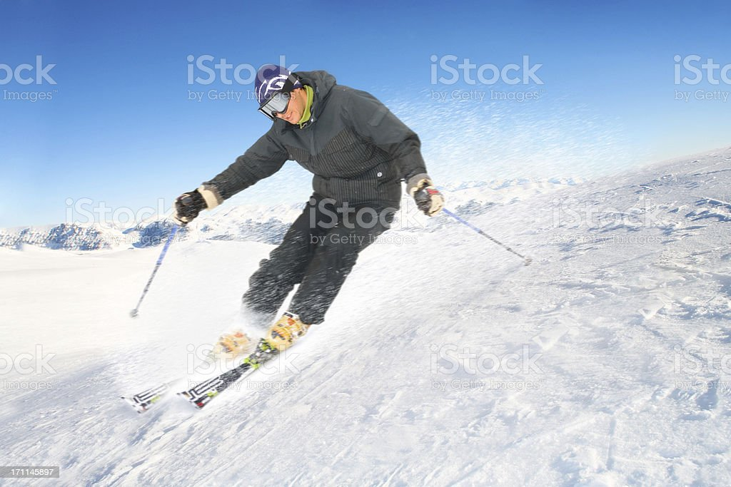 Male skiing on a sunny day - copy space royalty-free stock photo