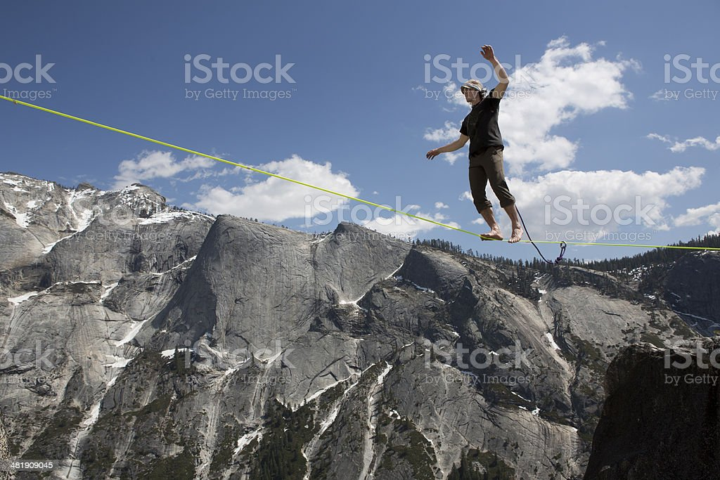 Male Slackliner Walking Yosemite Highline stock photo