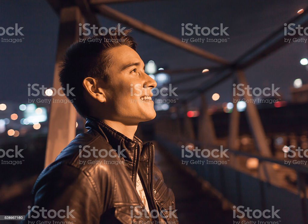 Male smiling in the city stock photo