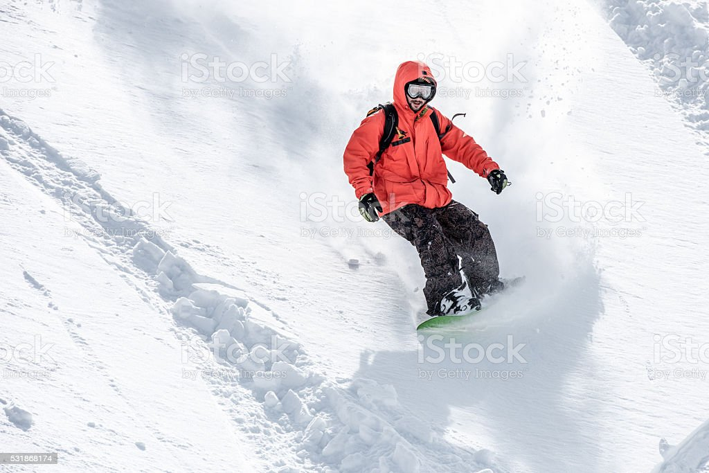 Male snowboarder in snow stock photo