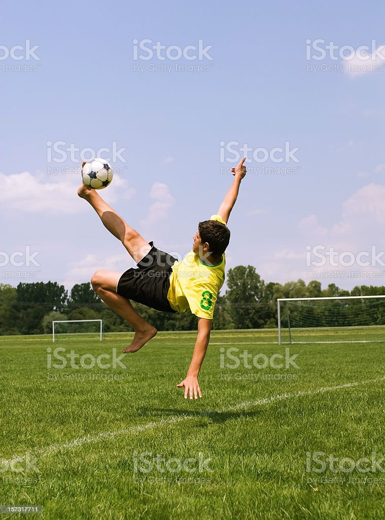 Male soccer player doing a bicycle kick royalty-free stock photo