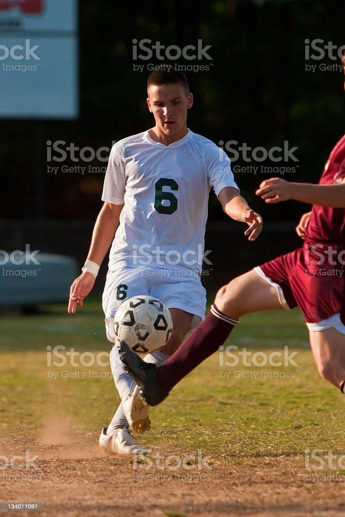Male Soccer Player Kicks Ball royalty-free stock photo