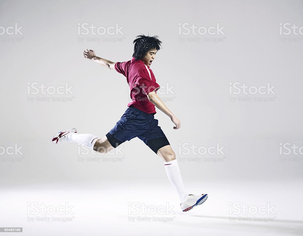 Male soccer player preparing to kick ball stock photo