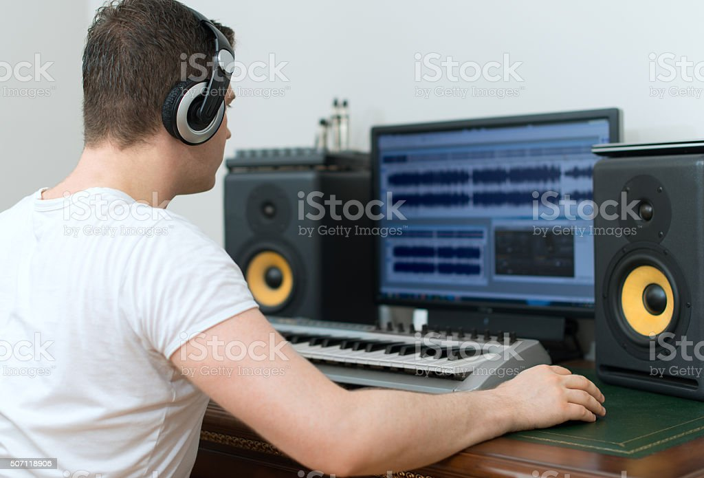 Male sound producer working in recording studio. stock photo