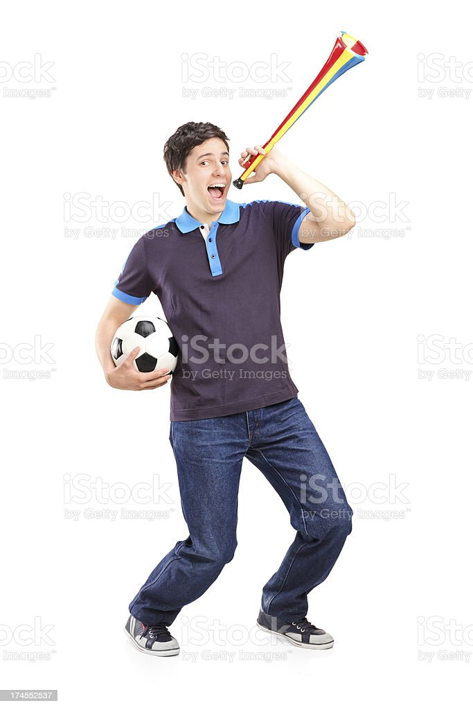 Male sport fan holding a football and horn royalty-free stock photo