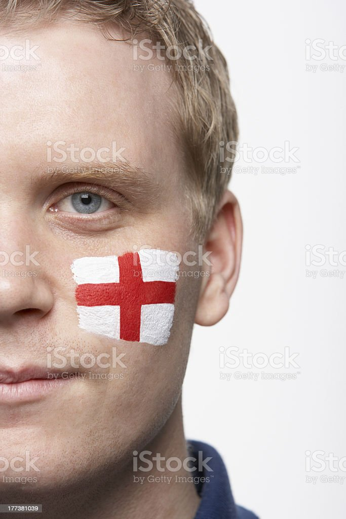 Male Sports Fan With St Georges Flag Painted On Face stock photo