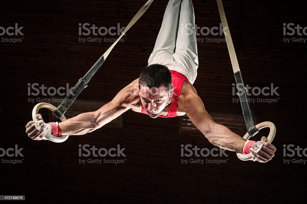 Male sportsman on gymnastics rings. stock photo