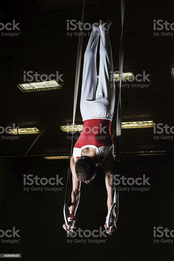 Male sportsman on gymnastics rings. royalty-free stock photo