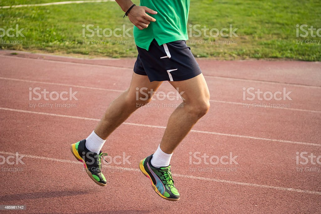 Male spriter muscular strong legs, close up. stock photo