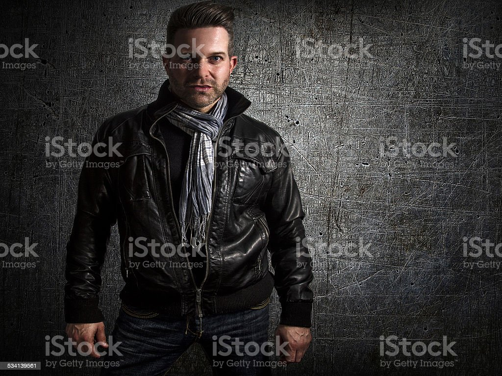 Male standing against a textured background stock photo