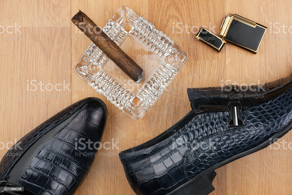 Male still life, classic men's shoes and a cigar stock photo