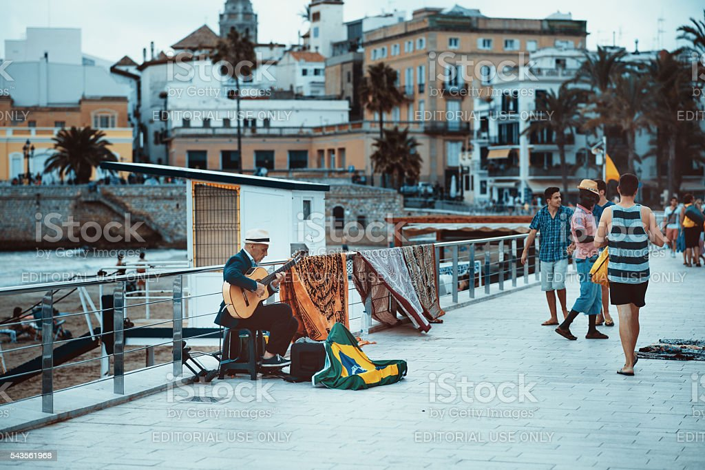 male street musician playing the guitar stock photo