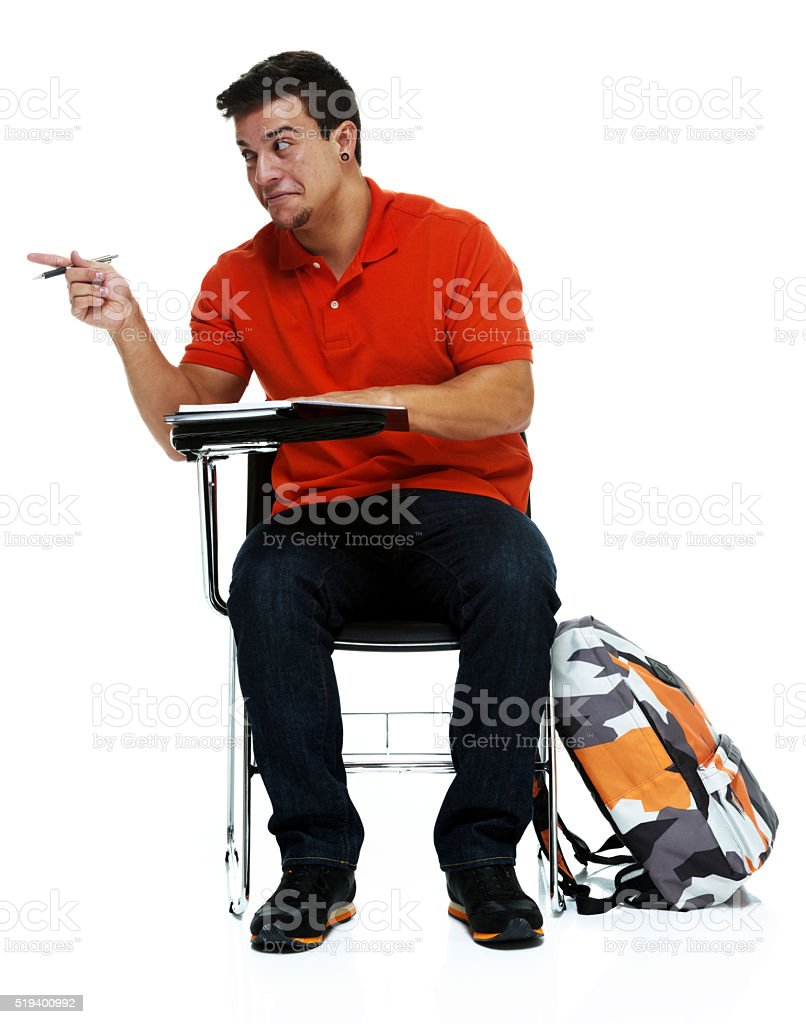 Male student pointing and being silly stock photo