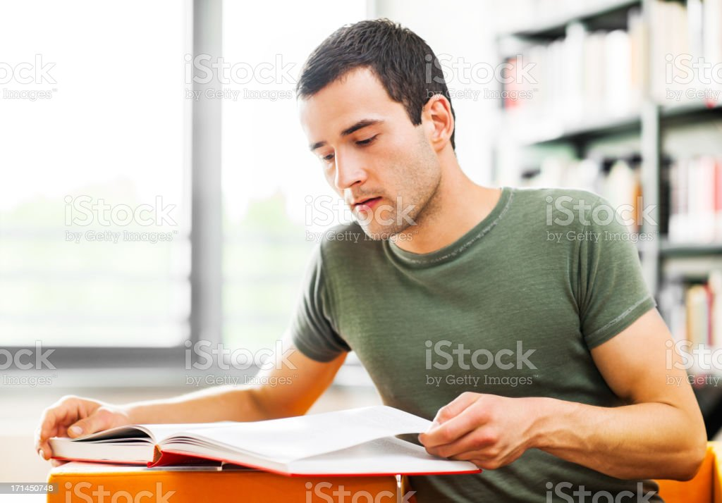Male student studying in the library. royalty-free stock photo