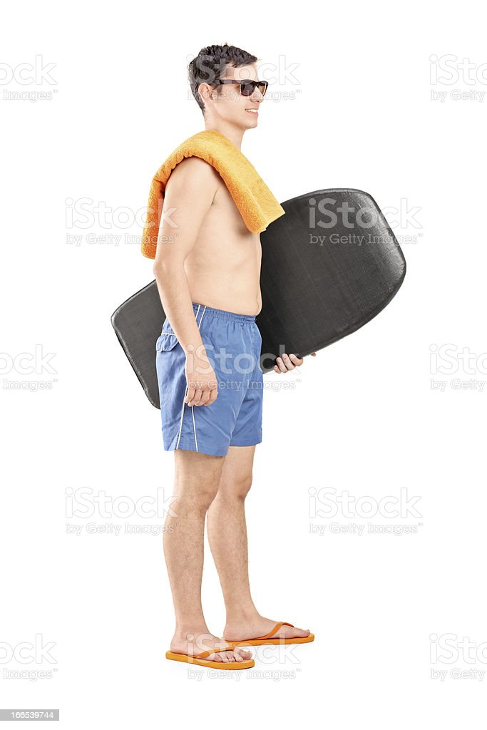 Male surfer holding a surfboard and posing royalty-free stock photo