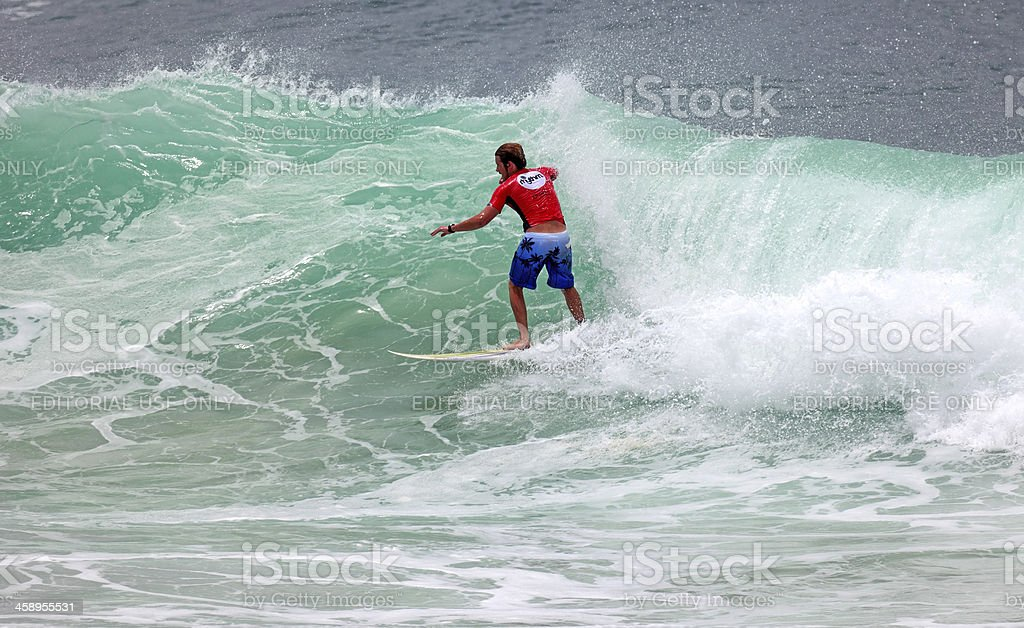 Male surfer riding a large swell after month long storms royalty-free stock photo