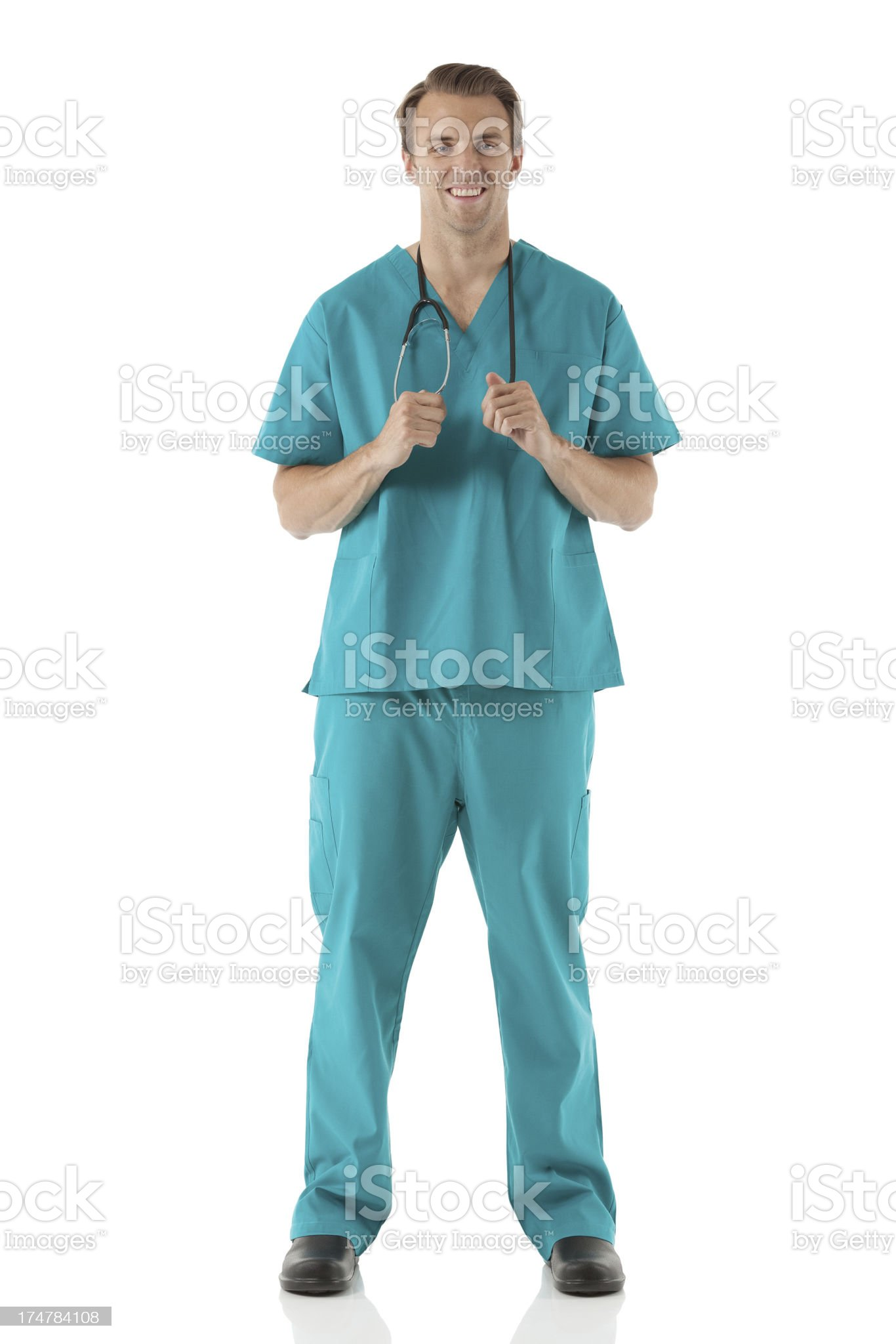 Male surgeon holding a stethoscope and smiling royalty-free stock photo