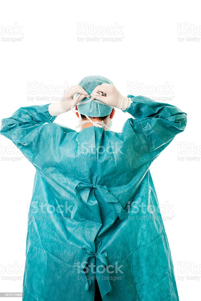 A male surgeon securing his mask to his head stock photo