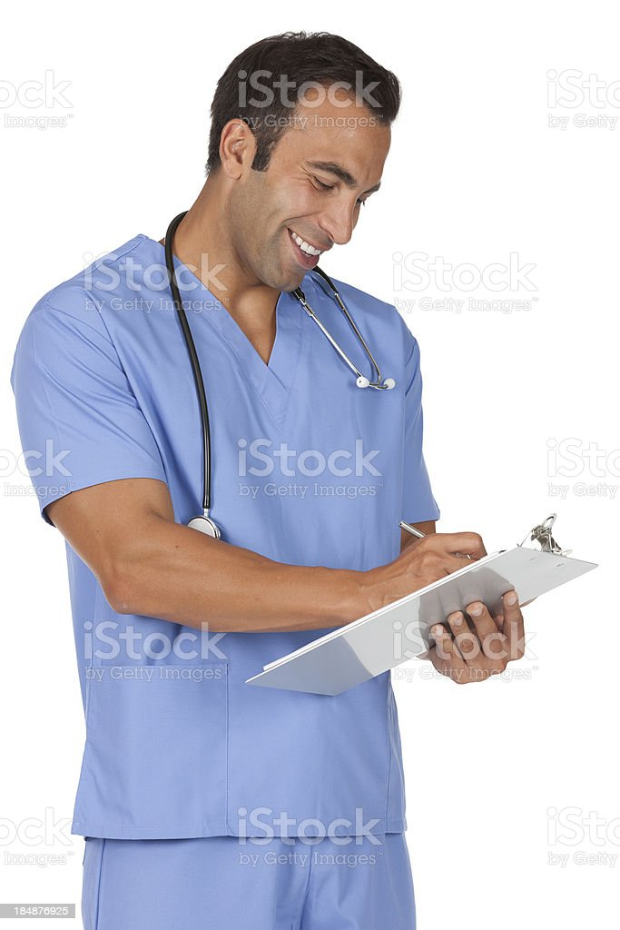 Male surgeon writing on a clipboard stock photo