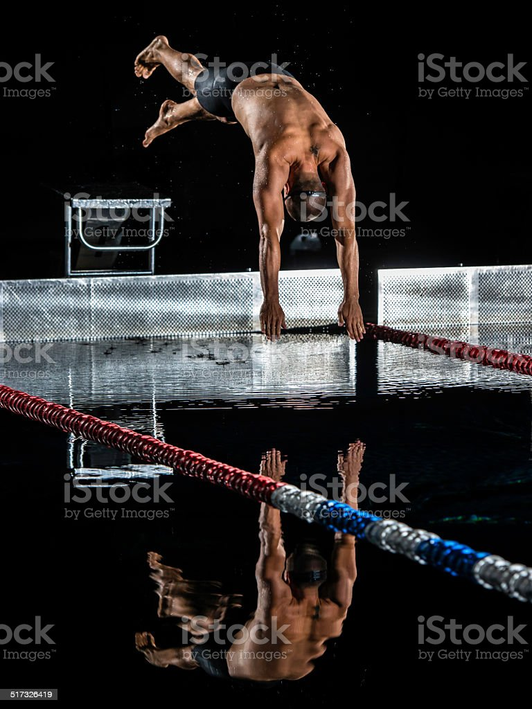 Male Swimmer In Mid-Air stock photo
