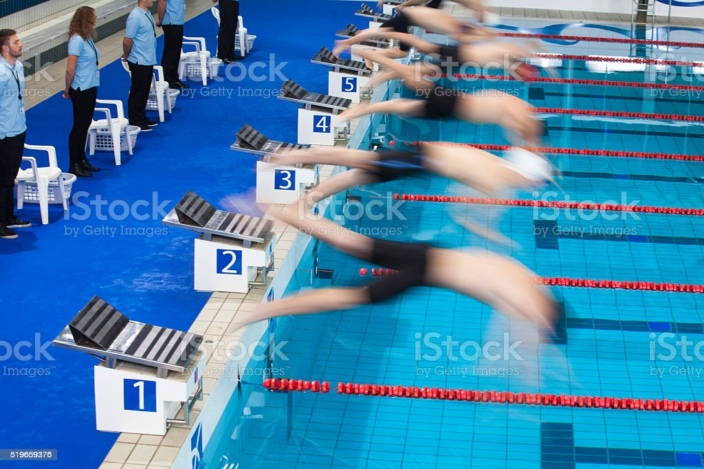 Male swimmer jumping stock photo