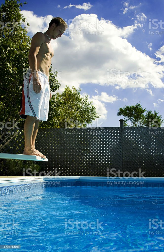 Male Swimmer Looking Into Pool royalty-free stock photo