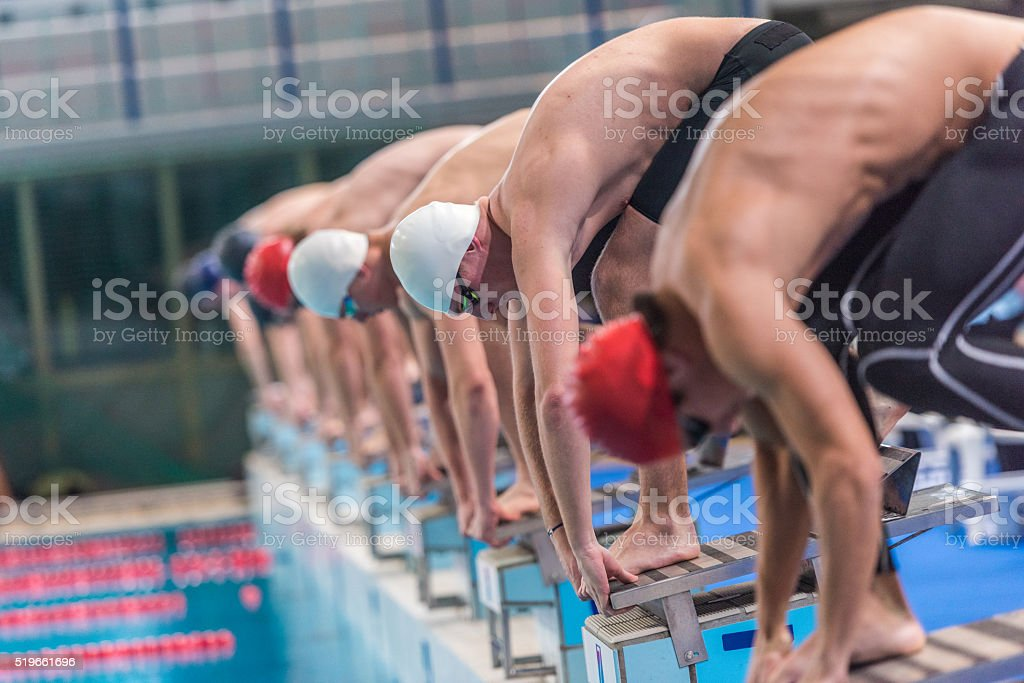 Male swimmer on starting block stock photo