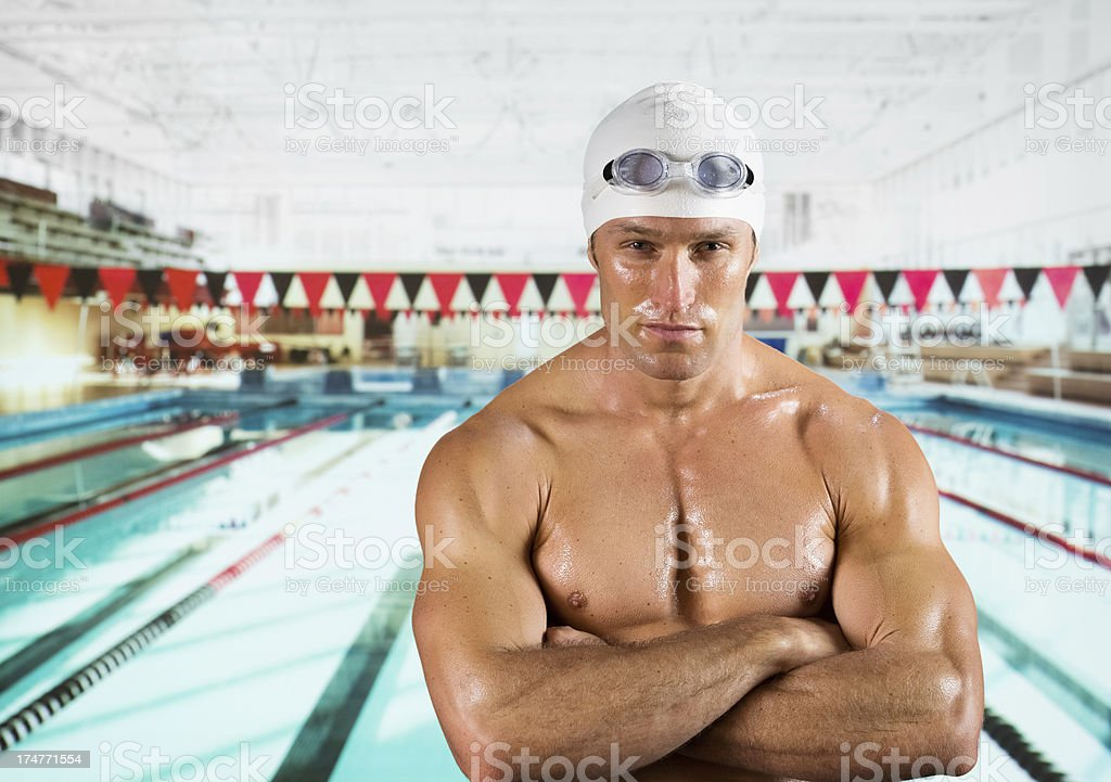 Male swimmer standing with his arms crossed stock photo