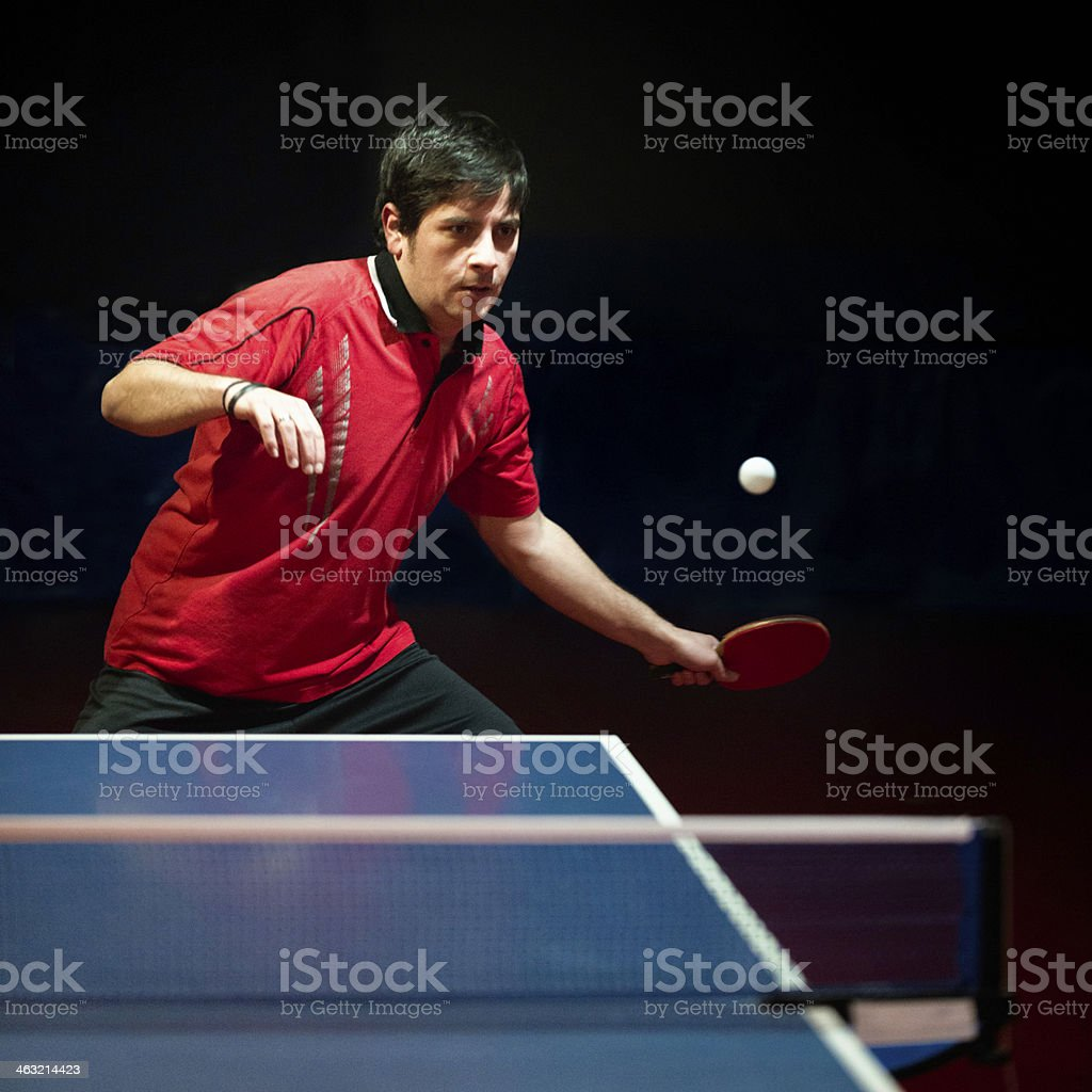 Male table tennis player hitting a ball royalty-free stock photo