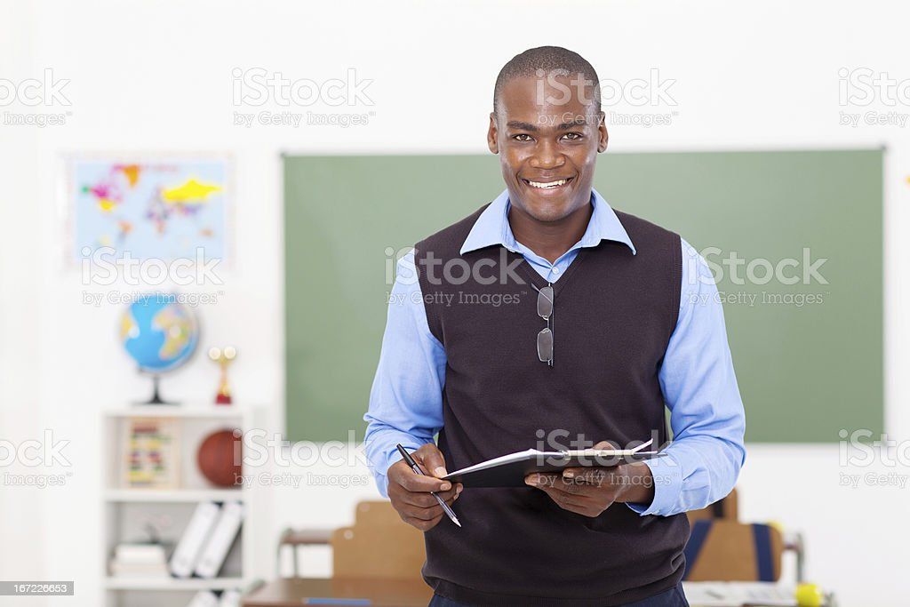 male teacher holding a clipboard royalty-free stock photo