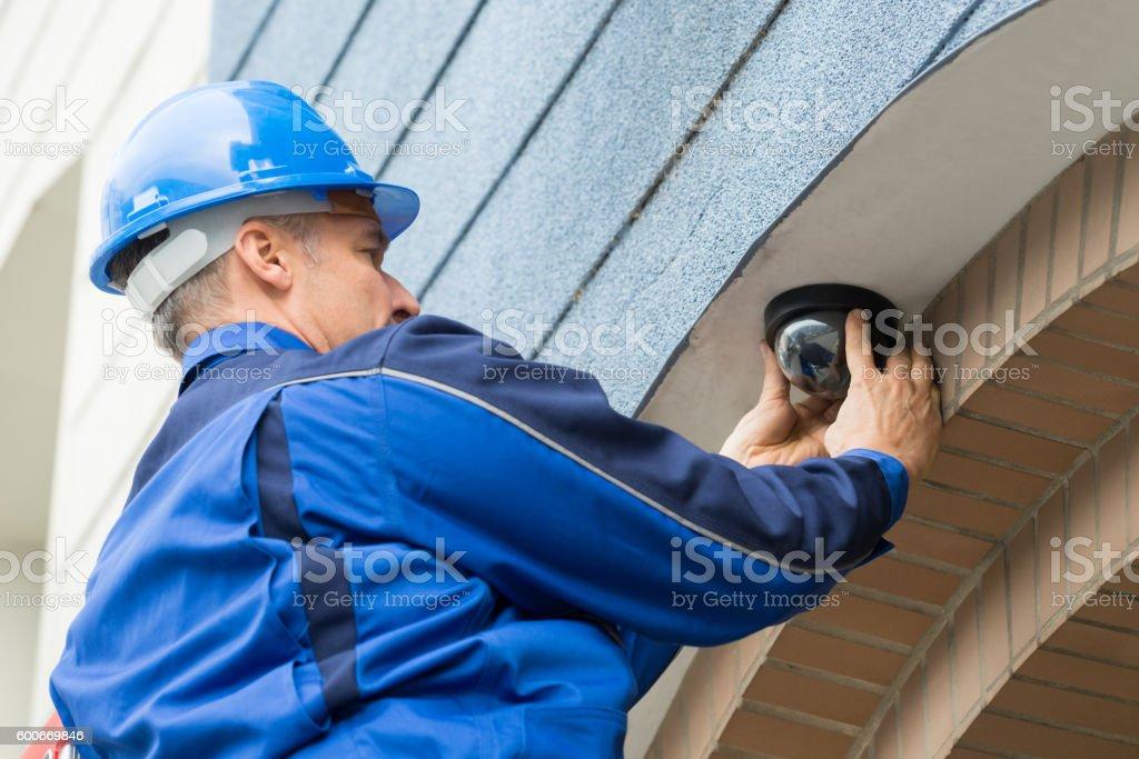 Male Technician Installing Camera stock photo