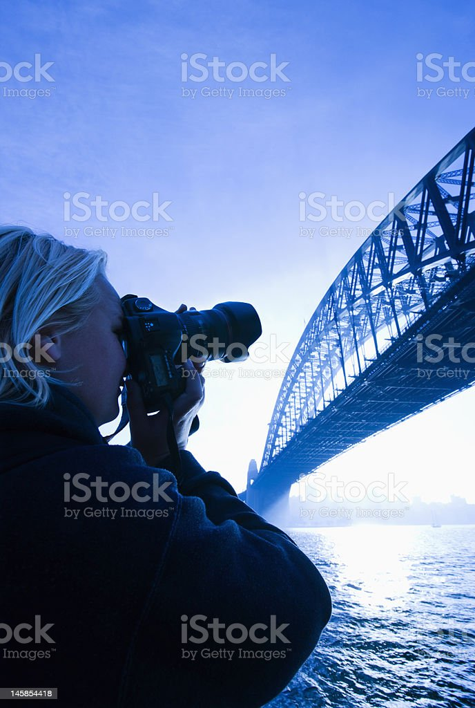 Male teen photographing bridge. royalty-free stock photo