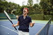 Male tennis player celebrating win