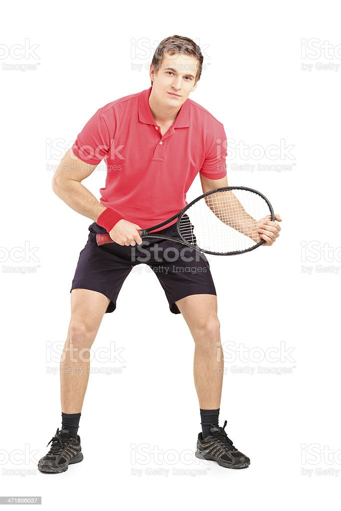Male tennis player holding a racket royalty-free stock photo