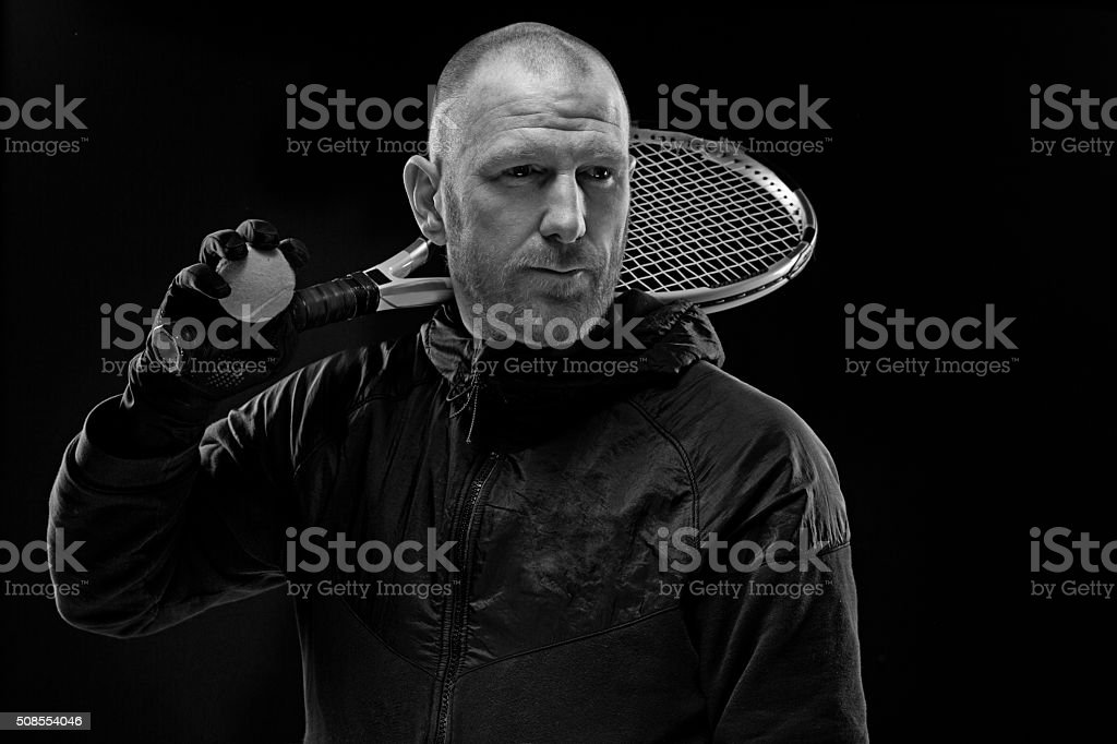 male tennis player holding racket stock photo