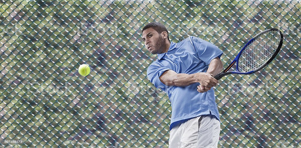 Male Tennis Player in Action royalty-free stock photo