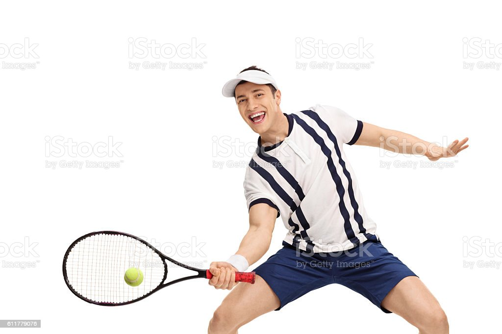 Male tennis player playing tennis stock photo