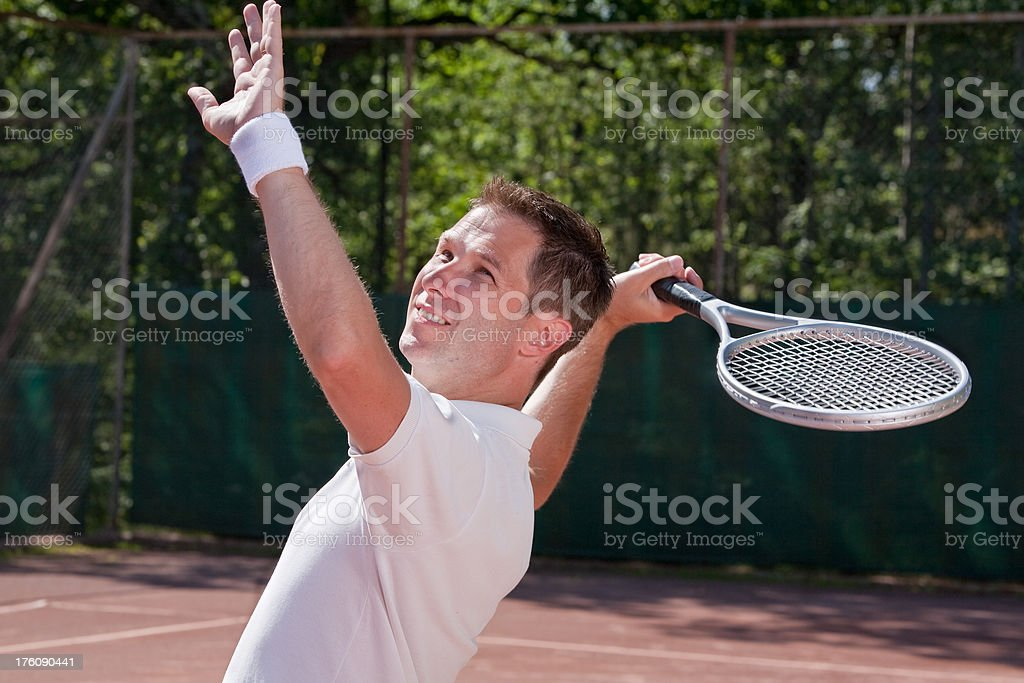 Male tennis player serving royalty-free stock photo