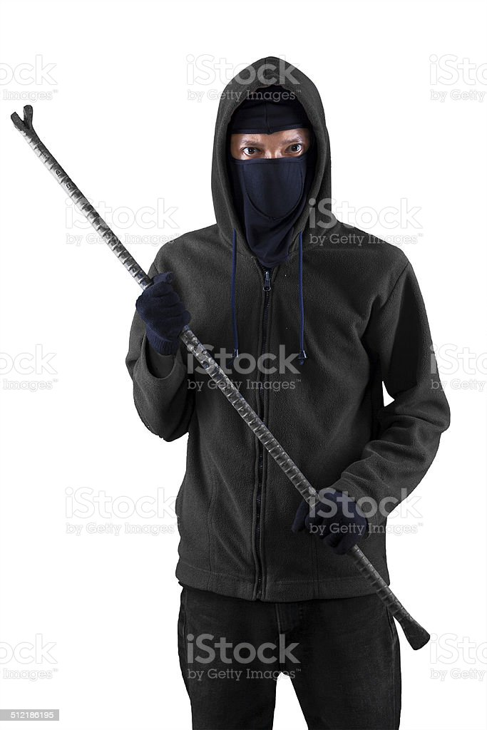Male thief holding crowbar stock photo