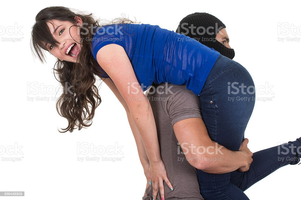 male thief kidnapping carrying young girl stock photo