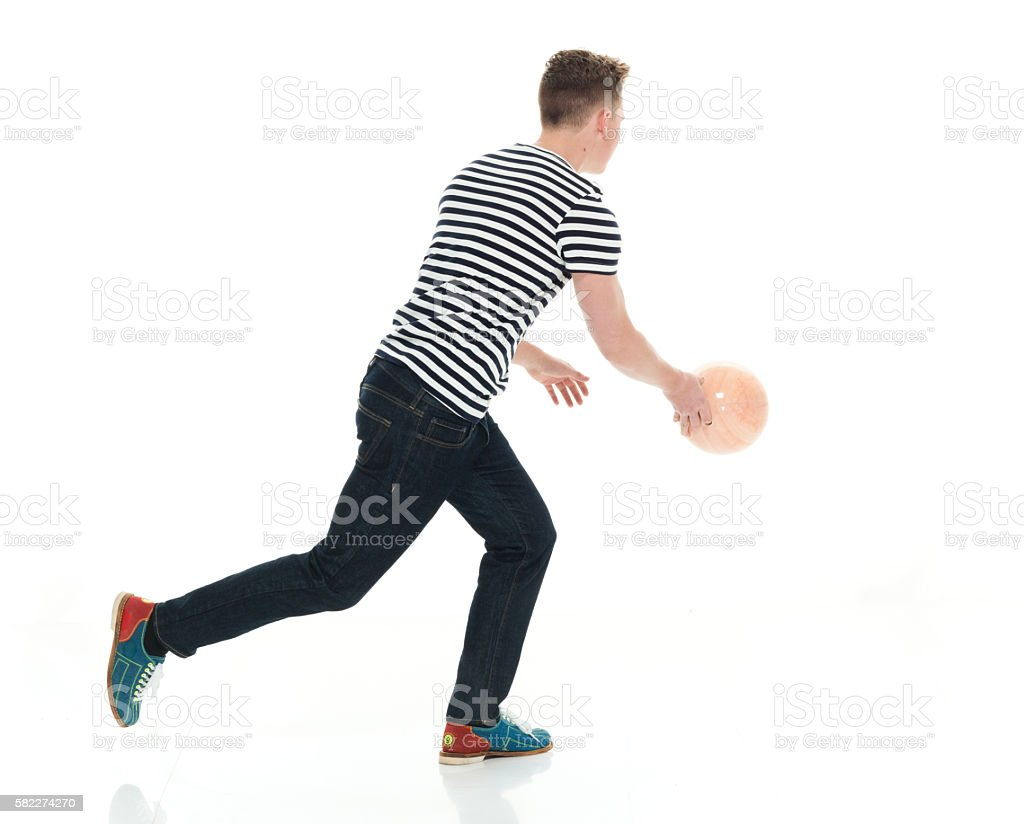 Male dribbling with bowling ball stock photo