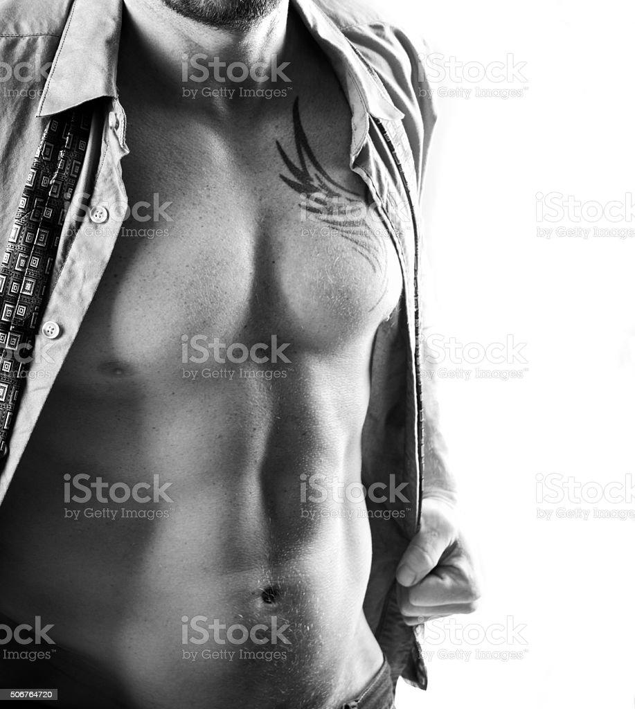 Male Torso Wearing Unbuttoned Shirt and Tie stock photo