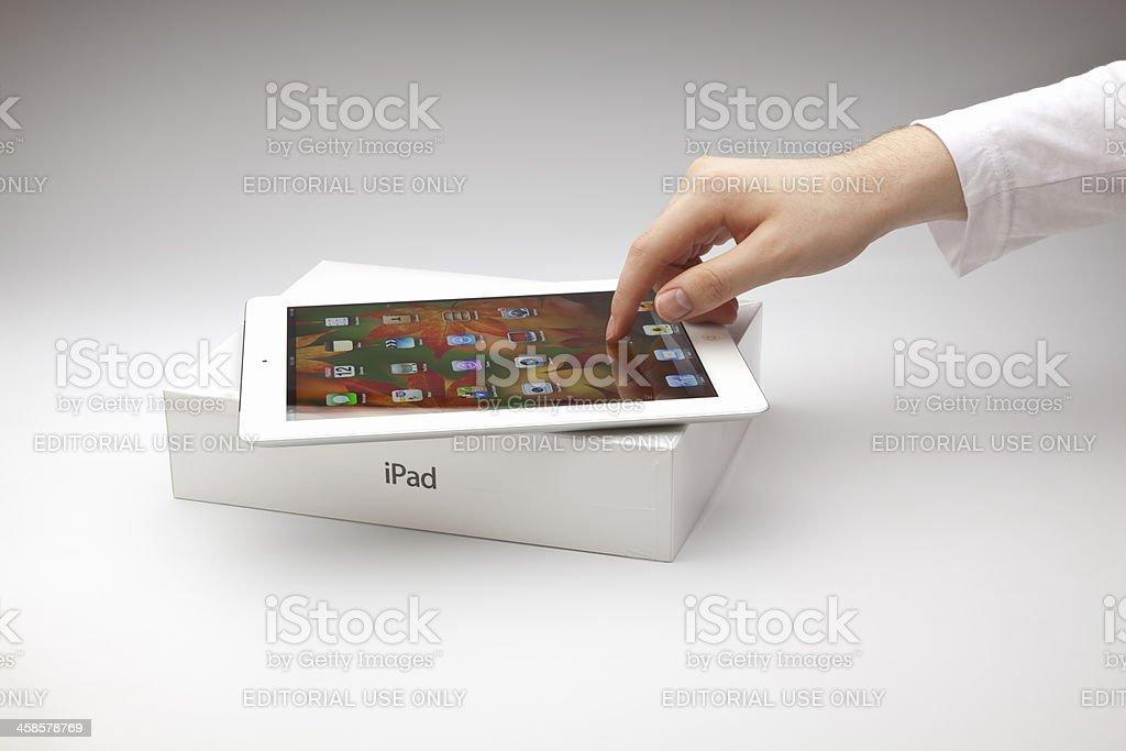 Male touching New ipad stock photo