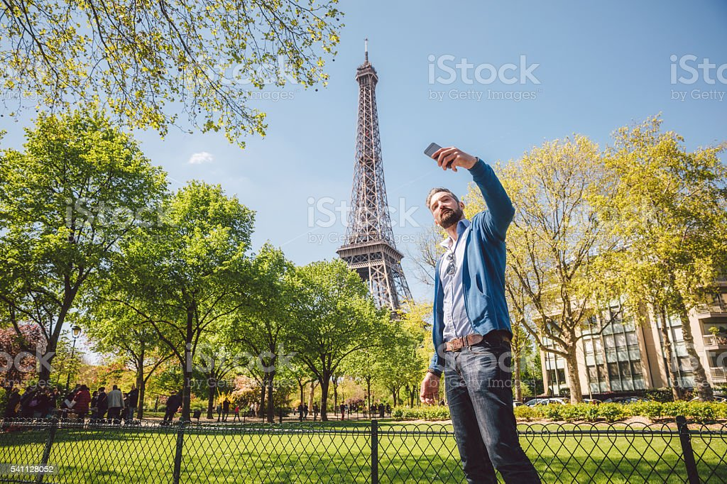 Male tourist taking a selfie in Paris, France stock photo