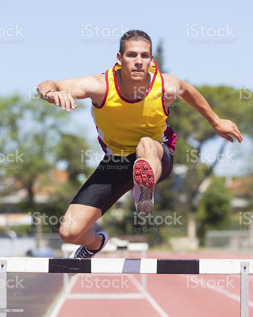 Male Track and Field Athlete during Obstacle Race stock photo