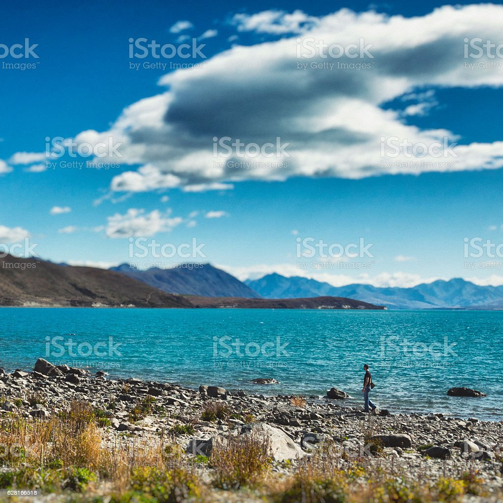 Male traveler at Lake Tekapo, New Zealand stock photo