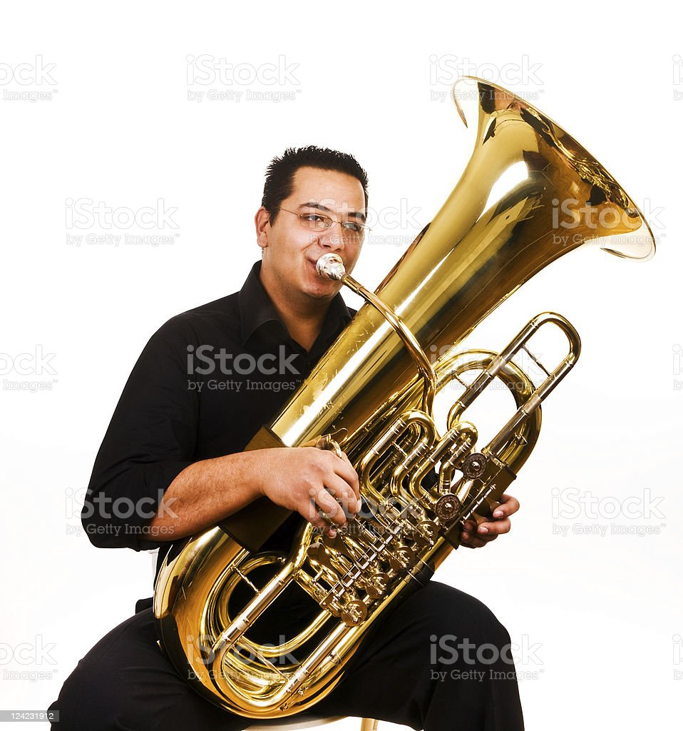 Male tubaist playing traditional tube instrument stock photo